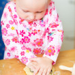 Adorable toddler girl helping at kitchen — Stock Photo #3903878