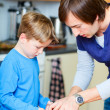 Royalty-Free Stock Photo: Father and son baking together