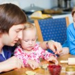 Father baking with his two kids — Stock Photo