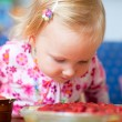 Adorable toddler with strawberry pie — Stock Photo #3903894
