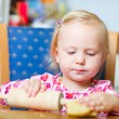 Toddler girl helping at kitchen — Stock Photo #3903905