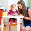 Mother and daughter drawing together — Stock Photo