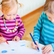 Stock Photo: Brother and sister drawing in their room