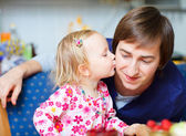 Adorable little girl kissing her father — Stock Photo