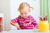 Toddler girl drawing with pencils — Stock Photo