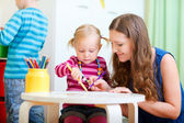 Mother drawing together with her daughter — Stock Photo