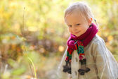 Toddler girl at autumn forest — Stock Photo