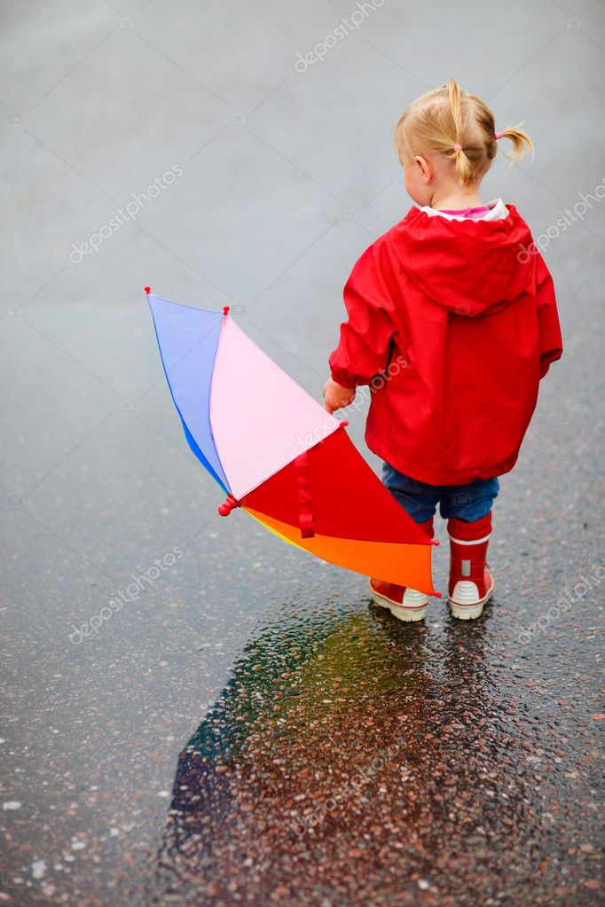 Back view of toddler girl outdoors at rainy day — Stock Photo #3903801