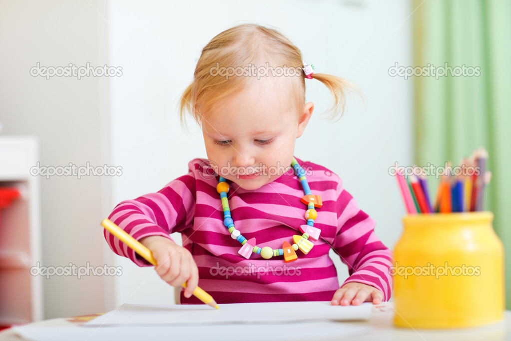 Adorable toddler girl drawing with pencils.  Stock Photo #3903907