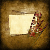Vintage background with film strip and card — Stock Photo