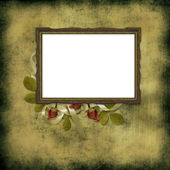 Old frame over grunge wallpaper and roses — Stock Photo