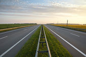 Highways along a field of sunflowers — Stock Photo