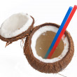 Stock Photo: Half open coconut with straws