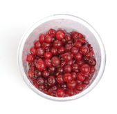 Cranberries in plastic glass — Stock Photo