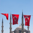 Mosque behind turkish flags — Stock Photo #3095565