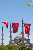 Mosque behind turkish flags — Stock Photo