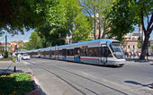 Modern tram on city street — Stock Photo