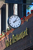 Clocks on the wall of the pub — Stock Photo