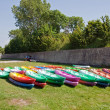 Kayaks lying on the grass - Stock Photo