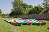 Kayaks lying on the grass — Stock Photo
