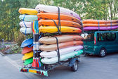 Trailer with kayaks and paddles — Stock Photo