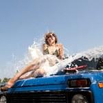 Girl in foam splash — Stock Photo