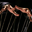 Conceptual series: hands of puppeteer with rope — Foto Stock #3006412