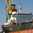 Stock Photo: Crane of cargo ship