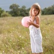 Little girl with ball — Stok fotoğraf
