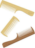 Set of wooden combs — Stock Vector