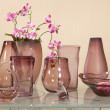 Set of vases on glass table - Stock Photo