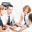 Stock Photo: Manager with office workers on meeting