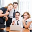 Manager with office workers on meeting in board room — Stock Photo