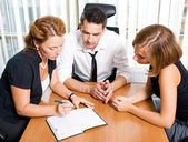 Manager with office workers — Stock Photo