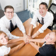 Office workers hold hands together — Stock Photo #3664528