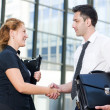Stock Photo: Handshake between office workers