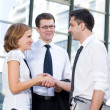Handshake between office workers — Stock Photo #3664537