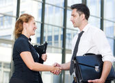 Handshake between office workers — Stock Photo