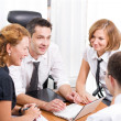 Stock Photo: Manager with office workers in board room