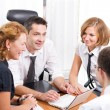 Manager with office workers in board room — Stock Photo #3690873