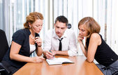 Manager with office workers on meeting — Stock Photo
