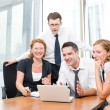 Manager with office workers in board room — Stock Photo #3710178