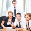 Manager with office workers in board room — Stock Photo