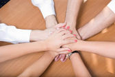Office workers hold hands together — Stock Photo