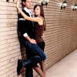 Pair stay near brick wall — 图库照片