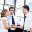 Handshake between office workers - Stock Photo