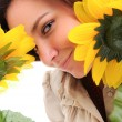 Woman and flower. - Stock Photo