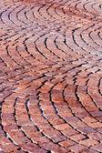 Red brick paved road pattern — Stock Photo