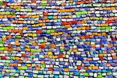 Horizontal colorful mosaic texture on wall — Stock Photo