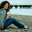 Woman on the sea shore with breakwater — Foto de Stock